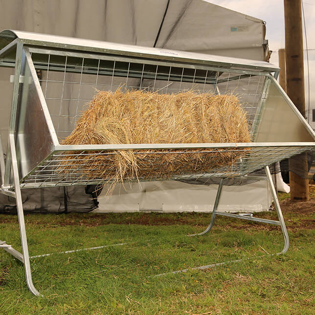 Tow-along hay racks