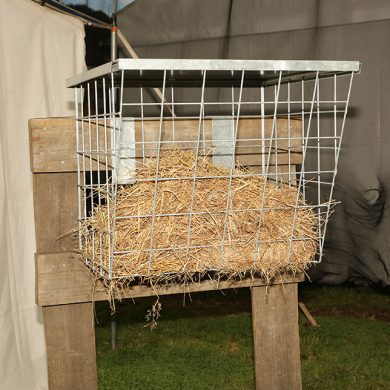 Fence mounted hay racks